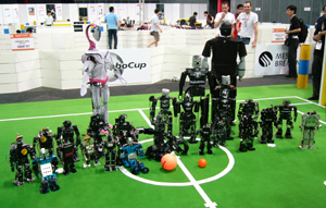 Some of the robots competing in the Humanoid League at RoboCup 2006